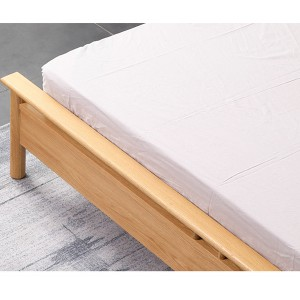 Heightened guardrail at the end of the bed