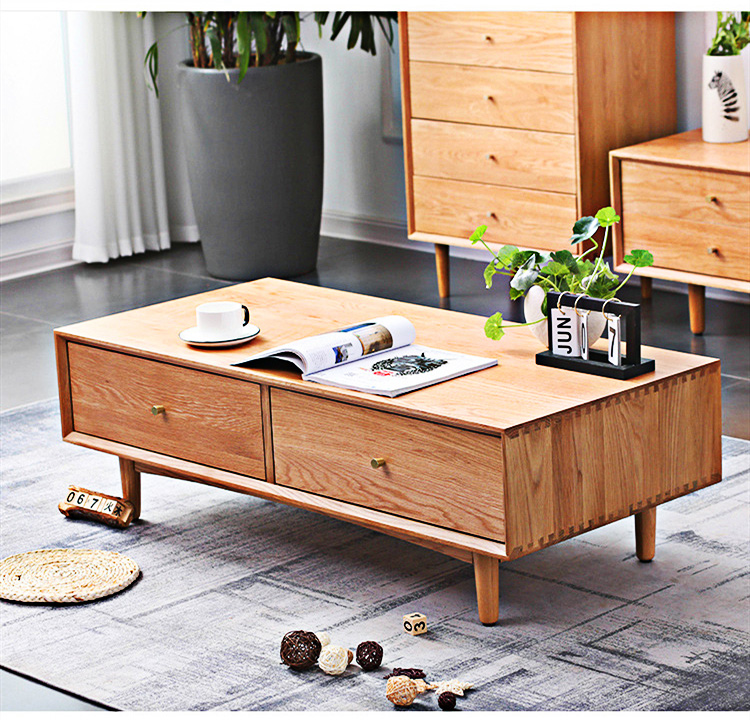 The Nordic simple four-drawer coffee table is made of natural solid wood, stylish and generous